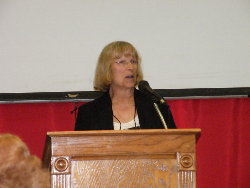 PUAFA President Nancy Nicholson Phillips welcomes guests to the banquet.