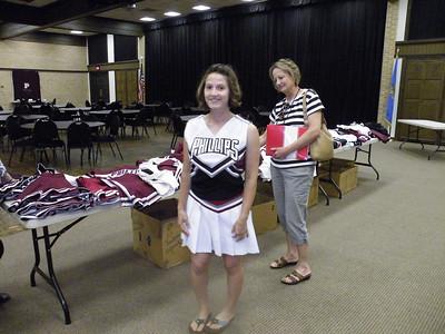 Lauren Elliott, granddaughter of Sheldon and Dorothy Elliott '48, proudly wears a PU cheerleading outfit. Her mother, Linda, looks on.
