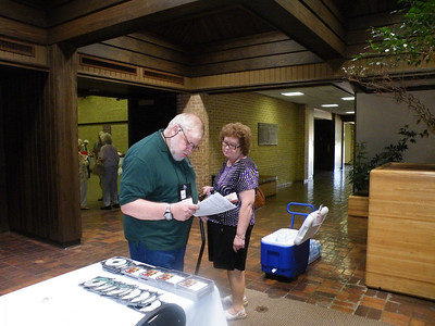 Dr. John Soper with wife Christine at registration.