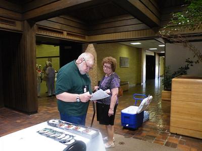 Dr. John Soper with wife Christine at registration.