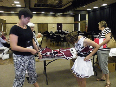 Board Member Tanya Hornish Reitan '91-92 helps Lauren Elliott select the best skirt for her PU Cheerleader outfit.
