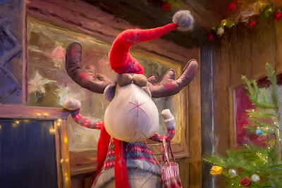 Funny stuffed reindeer in front of a decorated window