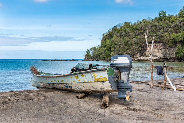 Caribbean bay with fishing boat with motor