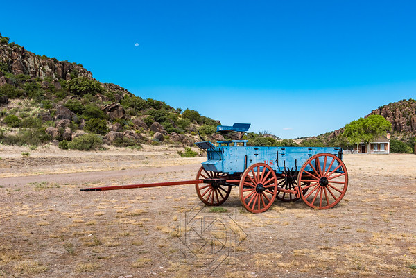 Blue chuck wagon with red spoked wheels