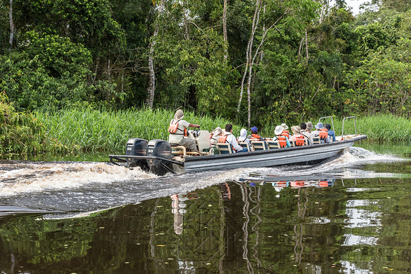 Tourist boat with passengers moving along the Rio Samiria tributary of the Amazon river