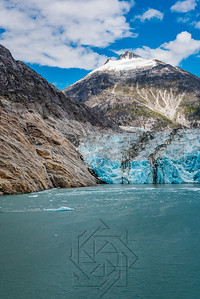 Portrait view of an Alaskan glacier with blue ice