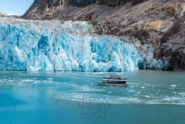 Close up view of tourist boat next to glacier face
