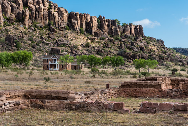 Ruins of fort buildings in the foreground with officer quarters in the background on Fort Davis
