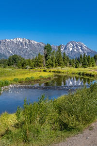 Schwabacher landing with river in the foreground and grand tetons in background