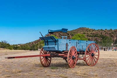 Close up view of old blue chuck wagon with red wheels