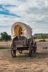 End view of a covered chuck wagon in west Texas