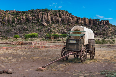 Canvas covered wagon with barrel on the side