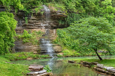 Small waterfall cascading over the canyon walls