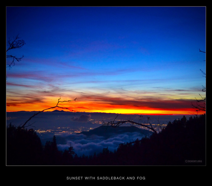 Sunset with Saddleback and fog.<br /> A sunset on the ocean side of Saddleback, with the lights of Redlands below, and the low clouds and fog settling in.