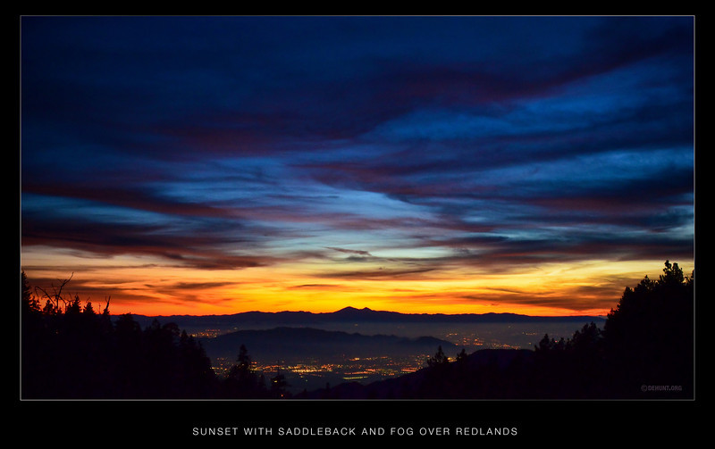 Sunset with Saddleback and fog over Redlands.<br /> Another wide angle view of Saddleback and the sunset, with a low fog creeping in over the lights of Redlands.