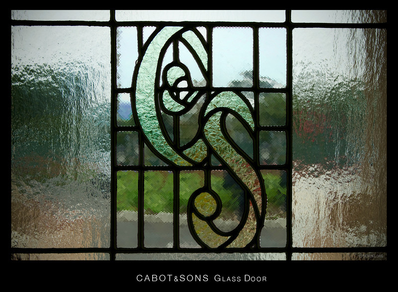 The front door glass at Cabot & Sons.