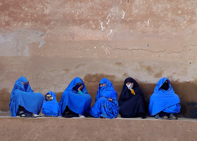 LADIES AT THE WALL - TAROUDANT, MOROCCO