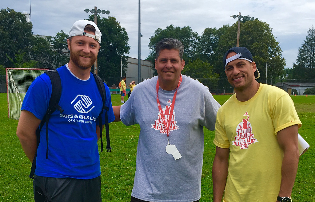 . From left, the Boys & Girls Club  Tyler Schermerhorn of Lowell, PUMA�s Co-Chair Rick Dupuis of Hudson and Danny Burgos of Tewksbury