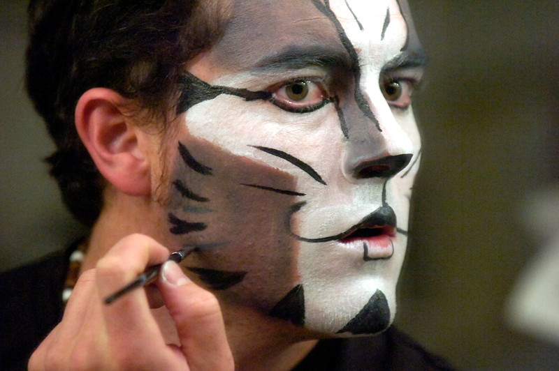 "CATS275.JPG Brian Jackson, who plays Munkustrap, the show's narrator a black and silver tom, applies his makeup in  the Boulder's Dinner Theatre dressing rooms on Tuesday April 26 2011. FOR MORE PHOTOS AND A VIDEO OF THE MAKEUP WORK GO TO  <a href=""http://WWW.DAILYCAMERA.COM"">http://WWW.DAILYCAMERA.COM</a><br /> Photo by Paul Aiken / The Camera / April 26"