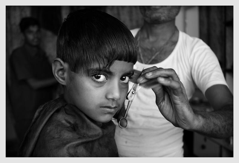 Boy in Barbers Shop.  Ragasthan, India 2010