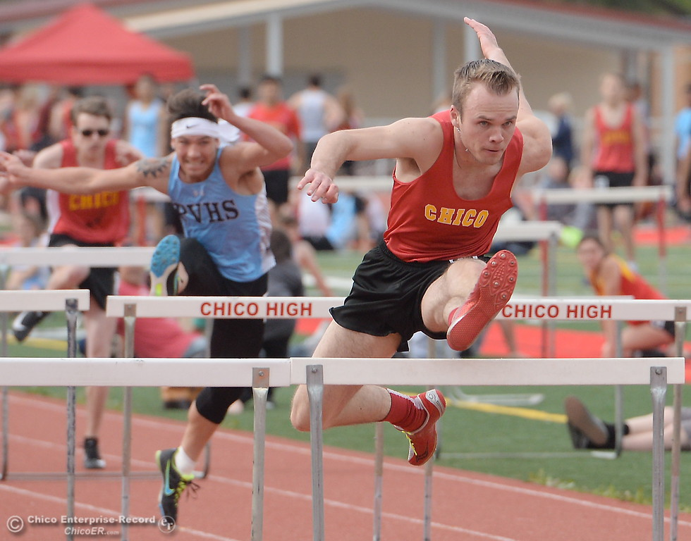 . Chico High Senior Trevor Trento takes the lead over PV\'s Chazz Osborne in the 100 Meter Hurdles during a Chico vs Pleasant Valley High School  dual track meet on the Chico High track Wednesday April 18, 2018.  (Bill Husa -- Enterprise-Record)