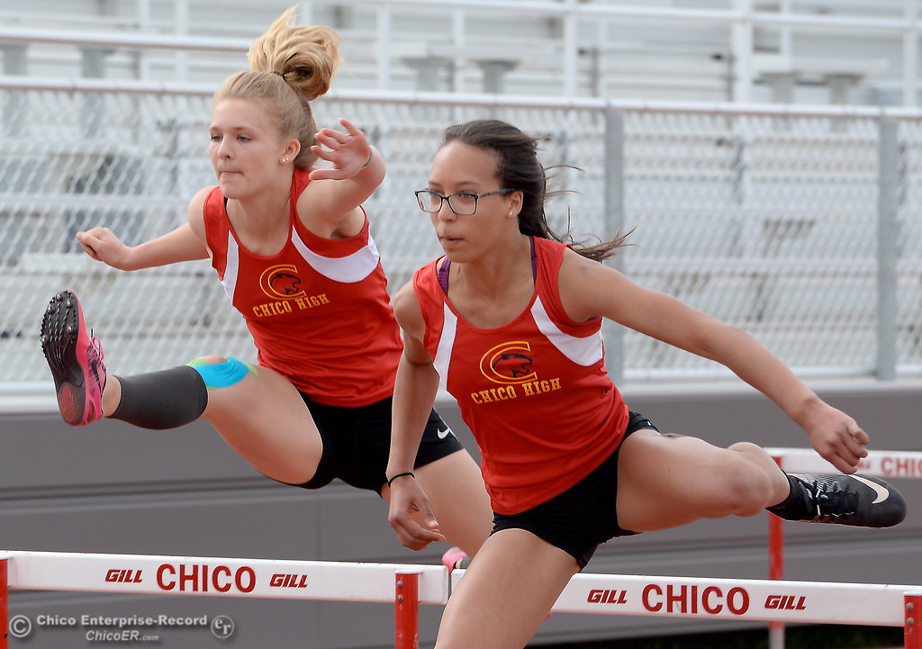 . Chico High Sophomore Hailey Fune breaks into the lead in the JV Girls 100 Meter Hurdles during a Chico vs Pleasant Valley High School  dual track meet on the Chico High track Wednesday April 18, 2018.  (Bill Husa -- Enterprise-Record)