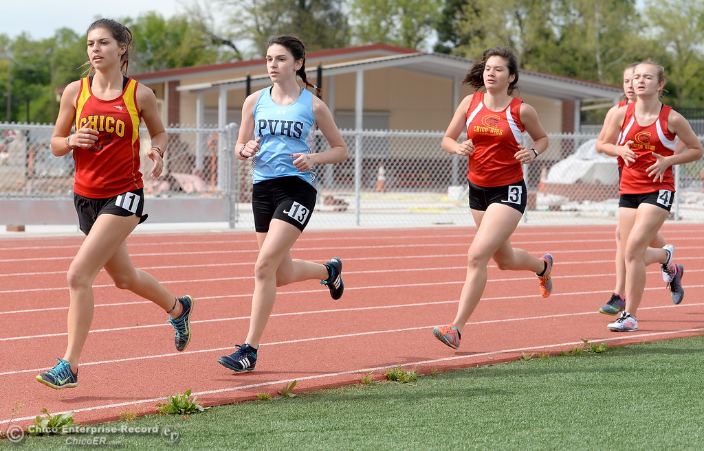 . Athletes compete in the girls varsity 1600 Meter Run during a Chico vs Pleasant Valley High School  dual track meet on the Chico High track Wednesday April 18, 2018.  (Bill Husa -- Enterprise-Record)