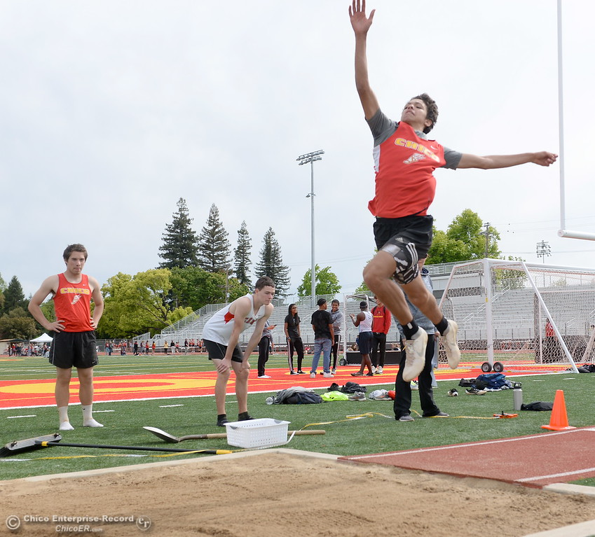 . Chico High long jumper Max Pollock jumps during a Chico vs Pleasant Valley High School  dual track meet on the Chico High track Wednesday April 18, 2018.  (Bill Husa -- Enterprise-Record)