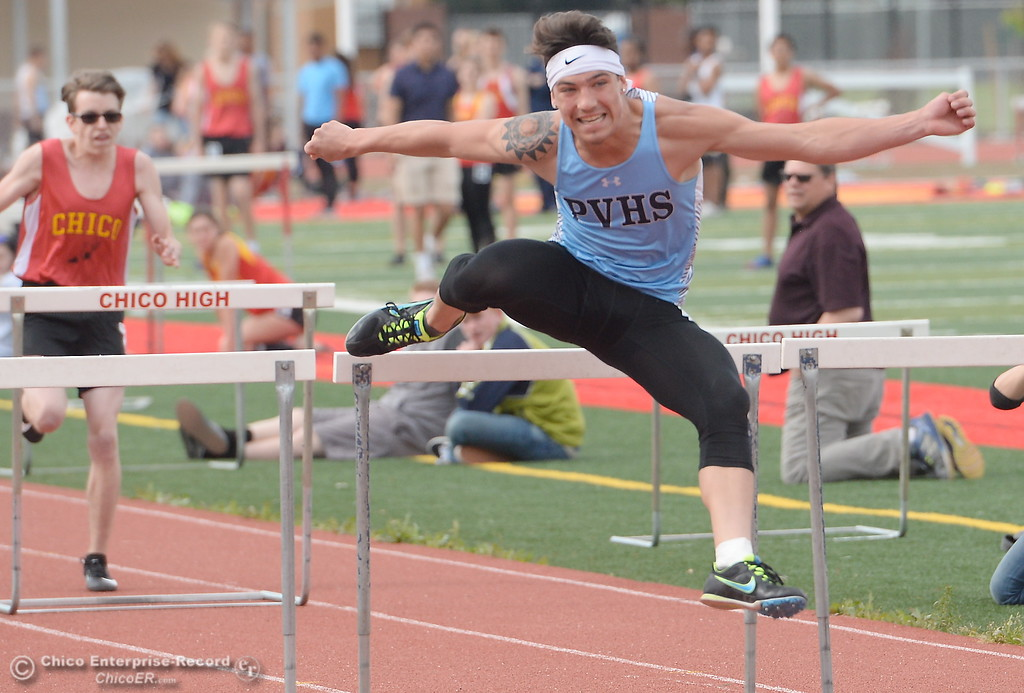 . PV\'s Chazz Osborne competes in the 100 Meter Hurdles during a Chico vs Pleasant Valley High School  dual track meet on the Chico High track Wednesday April 18, 2018.  (Bill Husa -- Enterprise-Record)