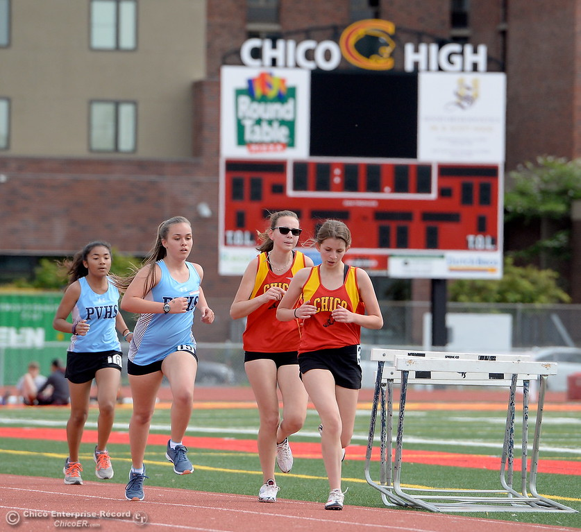 . Runners compete during a Chico vs Pleasant Valley High School  dual track meet on the Chico High track Wednesday April 18, 2018.  (Bill Husa -- Enterprise-Record)