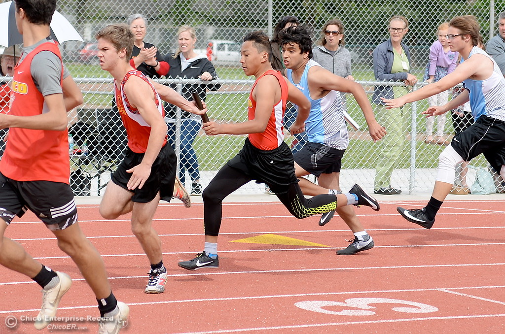 . Athletes compete in the 4x 100 relay during a Chico vs Pleasant Valley High School  dual track meet on the Chico High track Wednesday April 18, 2018.  (Bill Husa -- Enterprise-Record)
