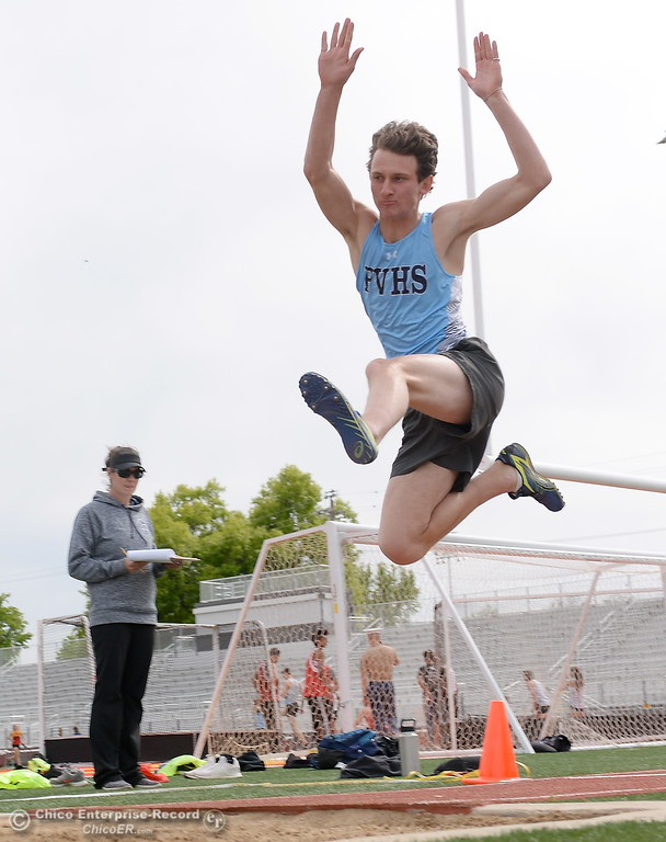 . Pleasant Valley High Long Jumper D.J. Merrill jumps during a Chico vs Pleasant Valley High School  dual track meet on the Chico High track Wednesday April 18, 2018.  (Bill Husa -- Enterprise-Record)