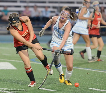 Chico's Catherine Bultema (13) gets the ball out during a battle with PV's Regan Seeman (11) during PV vs Chico Field Hockey at Asgard Yard in Chico, Calif. Wed. Sept. 19, 2018.   (Bill Husa -- Enterprise-Record)