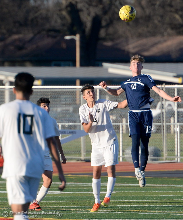. PV\'s #10 Ari Reyes gets a head on the ball beside Chico\'s #4 Jesus Rangel during Pleasant Valley vs Chico High Boys soccer action at Chico High Wed. Feb. 7, 2018. (Bill Husa -- Enterprise-Record)