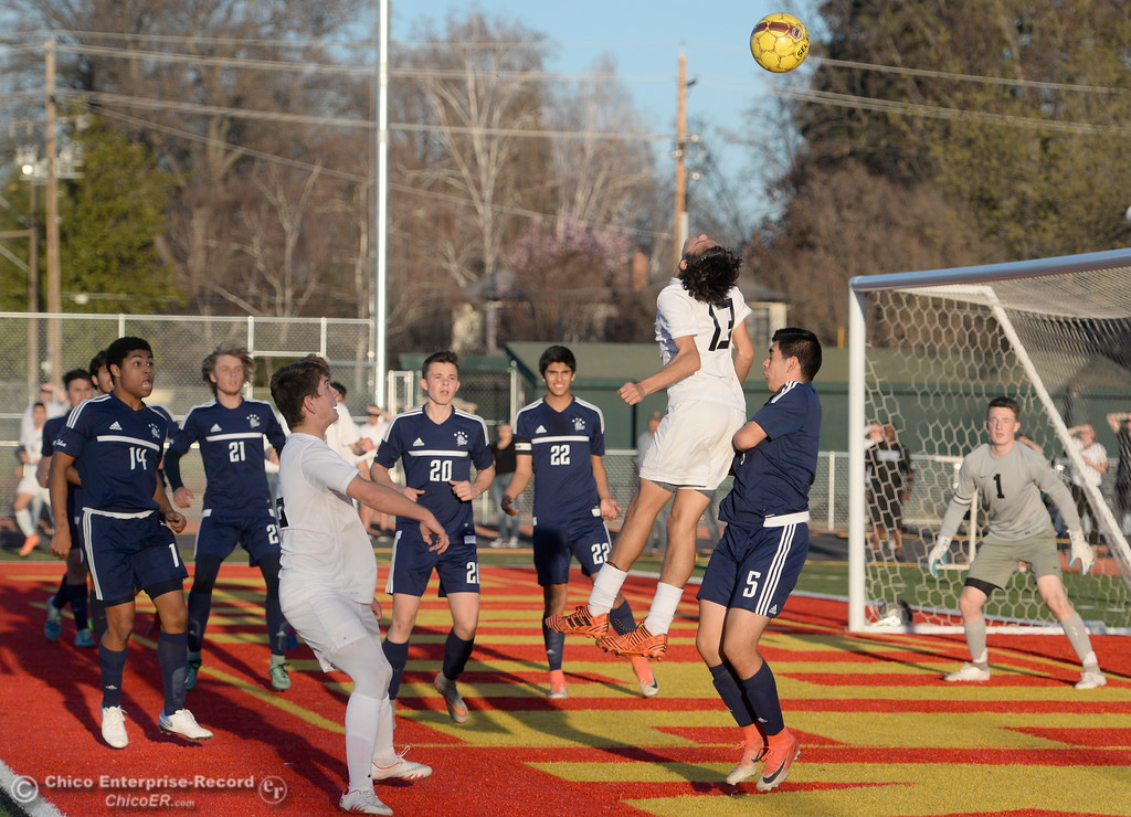 . Chico\'s #13 Cladio Quezada goes high for a head shot in traffic near the PV goal during Pleasant Valley vs Chico High Boys soccer action at Chico High Wed. Feb. 7, 2018. Unfortunately Quezada would injure his knee on the play. (Bill Husa -- Enterprise-Record)