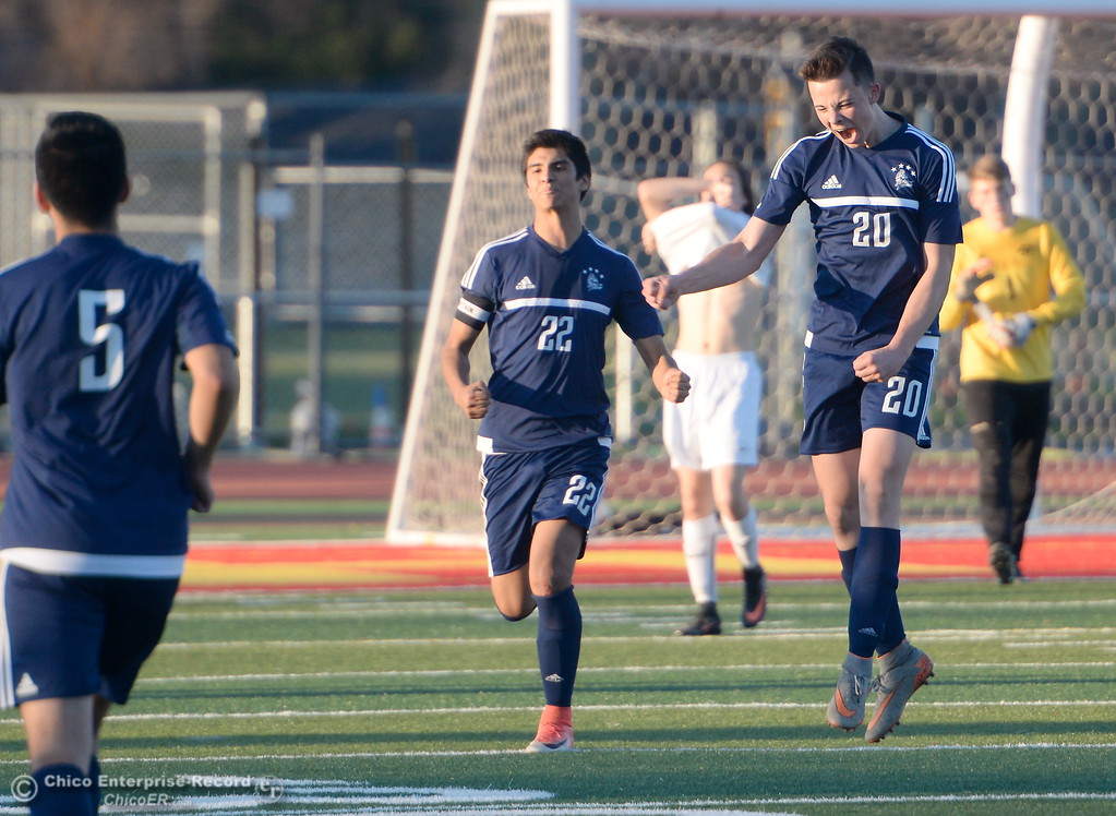 . An exuberant Thomas Gevers jumps for joy after the whistle blows ending the Pleasant Valley vs Chico High Boys soccer battle with a PV win 2-1 over Chico at Chico High Wed. Feb. 7, 2018. (Bill Husa -- Enterprise-Record)