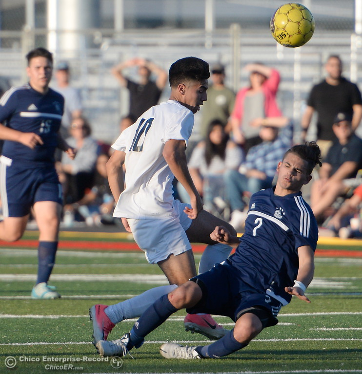 . Chico\'s Tou Lee Thao and PV\'s Akia Ramirez collide during a hard fought battle between Pleasant Valley vs Chico High Boys soccer action at Chico High Wed. Feb. 7, 2018. (Bill Husa -- Enterprise-Record)