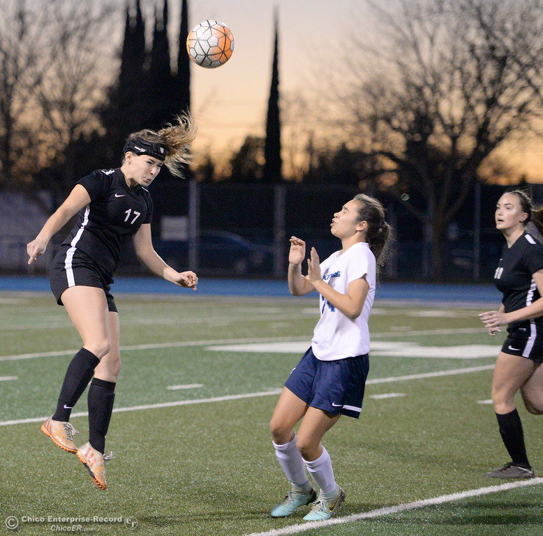 . Chico\'s Isabel Bishop gets her head on a ball over PV\'s #24 (not on roster) during Chico High vs Pleasant Valley Girls soccer action at Pleasant Valley High School Wed. Feb. 7, 2018. (Bill Husa -- Enterprise-Record)