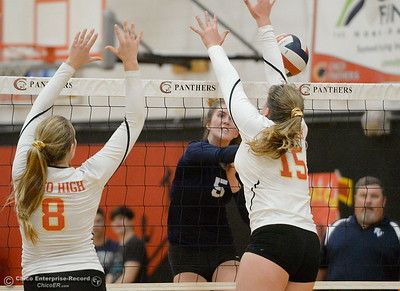 PV's Julia Shepherd (5) spikes one over Chico's Eliana Sheridan (15) and Adair Hotmer (8) during PV vs Chico volleyball at Chico High Tuesday Oct. 2, 2018.   (Bill Husa -- Enterprise-Record)