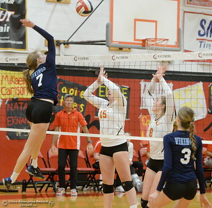 PV's Alexa Hitchko (7) hits one over Chico's Eliana Sheridan (15) and Adair Hotmer (8) while PV's Jordan Bennett (3) watches the net during PV vs Chico volleyball at Chico High Tuesday Oct. 2, 2018.   (Bill Husa -- Enterprise-Record)