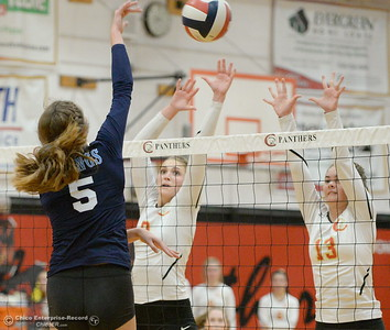 PV's Julia Shepherd hits one over Chico's Adai Hotmer (8) and Camille Hensley (13) during PV vs Chico volleyball at Chico High Tuesday Oct. 2, 2018.   (Bill Husa -- Enterprise-Record)