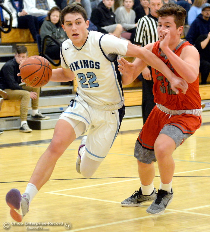 . PV #22 Kevin Kremer drives to the basket past Foothill #32 Simon Turner during first half action of Foothill vs Pleasant Valley High Boys basketball at PV Tues. Feb. 13, 2018. (Bill Husa -- Enterprise-Record)
