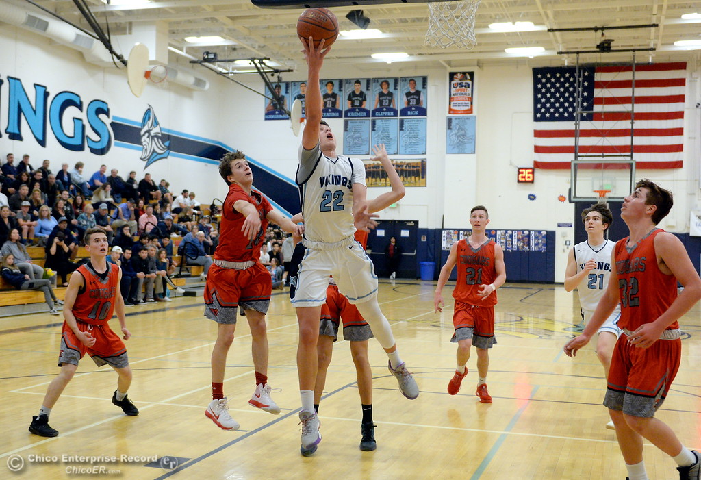 . PV #22 Kevin Kremer goes up for a layup in traffic during first half action of Foothill vs Pleasant Valley High Boys basketball at PV Tues. Feb. 13, 2018. (Bill Husa -- Enterprise-Record)