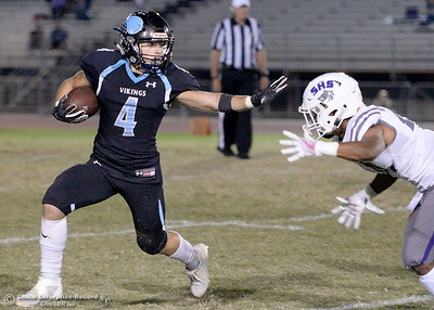 PV's Caleb Cooley (4) gets away from Shasta's Charles Dietrich (24) with a straightarm during PV vs Shasta High Football at University Stadim in Chico, Calif. Friday Sept. 28, 2018.  (Bill Husa -- Enterprise-Record)
