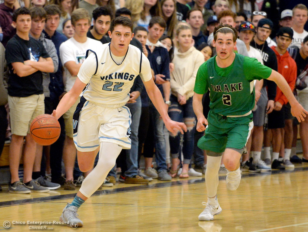 . PV #22 Kevin Kremer drives past Drake #2 Noah Bice during playoff basketball at Pleasant Valley High School in Chico, Calif. Wed. March 7, 2018. (Bill Husa -- Enterprise-Record)