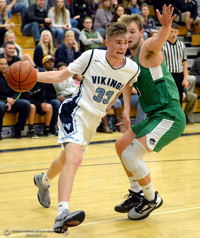 . PV #33 Jake Rick drives around Drake #5 Danny Roland during playoff basketball at Pleasant Valley High School in Chico, Calif. Wed. March 7, 2018. (Bill Husa -- Enterprise-Record)