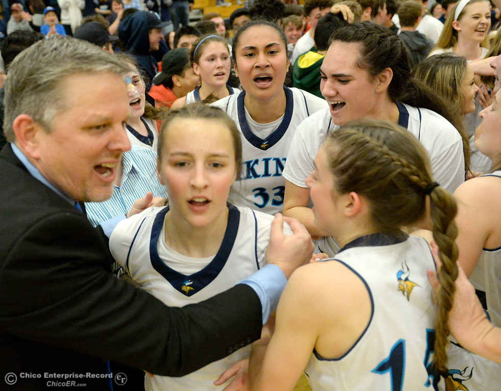 . PV Head Coach Bob Paddock pulls Chloe Mayer out of the pile after their exciting win against Sacramento at Pleasant Valley High School in Chico, Calif. Wed. March 7, 2018. (Bill Husa -- Enterprise-Record)