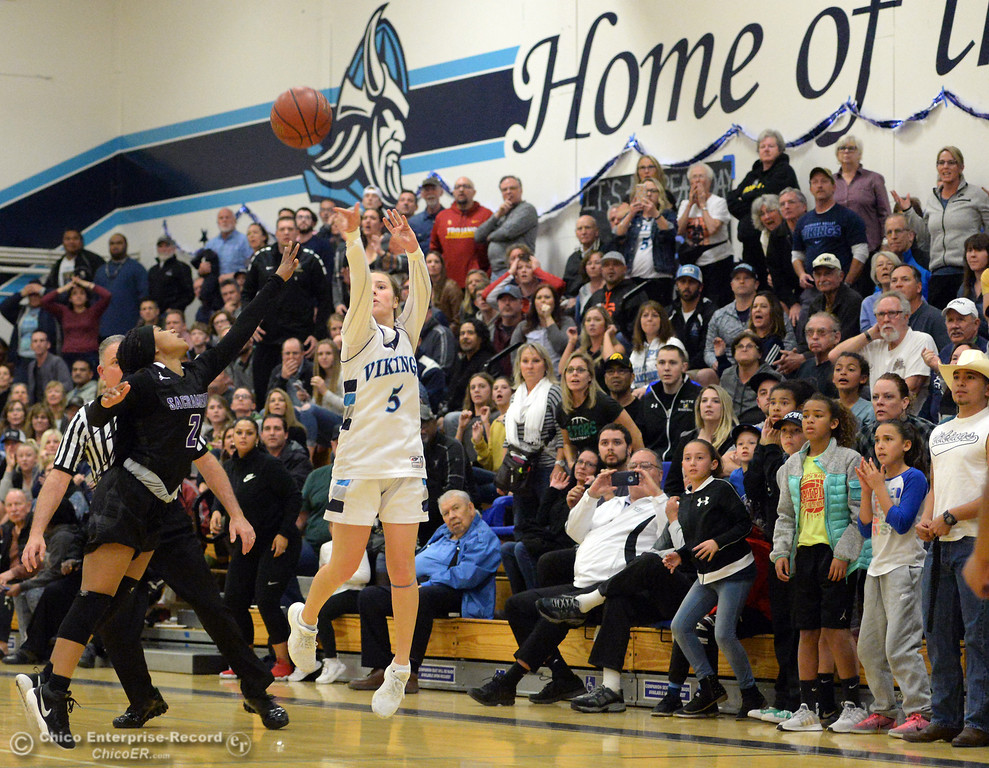 . PV #5 Chloe Mayer drains a long three pointer at the buzzer to beat Sacramento 47-46 during playoff basketball at Pleasant Valley High School in Chico, Calif. Wed. March 7, 2018. (Bill Husa -- Enterprise-Record)