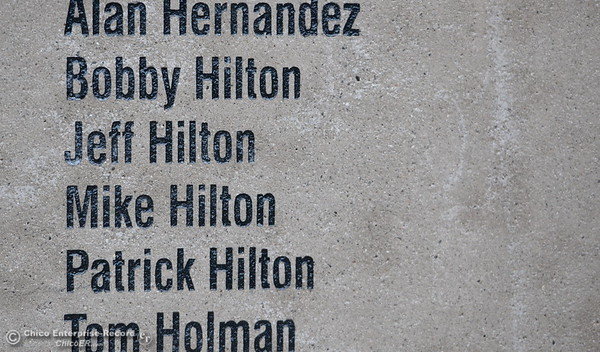 "Veteran Patrick Hilton of Chico checks out a wall of names after the Veterans Glen dedication ceremony at Pleasant Valley High School in Chico, Calif. Wed. Nov. 30, 2016. Hilton said ""We have a lot of family on the wall, this is terrific!"" referring to the four members of the Hilton family listed. (Bill Husa -- Enterprise-Record)"
