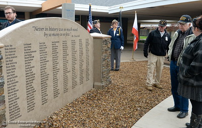 Veterans check out a wall of names that is a tribute to all of the current and former members of the military who also attended PVHS following the Veterans Glen dedication ceremony at Pleasant Valley High School in Chico, Calif. Wed. Nov. 30, 2016. (Bill Husa -- Enterprise-Record)